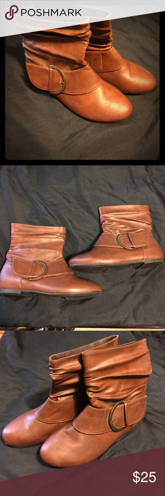 Brown boots size 8 Adorable brown boots size 8. Have a buckle on the outside. They are narrow which is why I'm selling them. Only worn around the house. In like new condition Maurices Shoes Ankle Boots & Booties