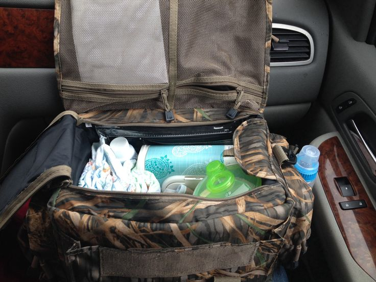 Ducks and diapers! Use a waterproof duck hunting bag as a diaper bag, cheaper and when baby is older he has his first duck hunting bag already!!