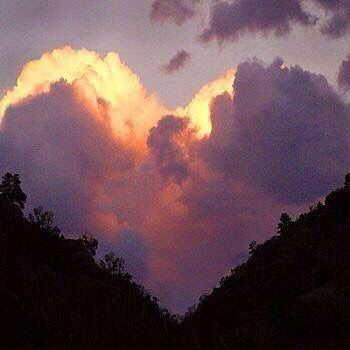The heaven's declare the Glory of God!! This cloud between mountains looks like a heart. God's love is unmeasurable!!