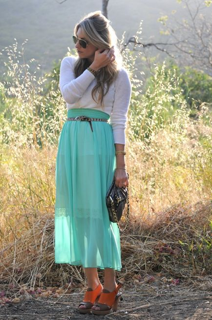 Try a bright turquoise maxi skirt with long sleeve top and skinny belt