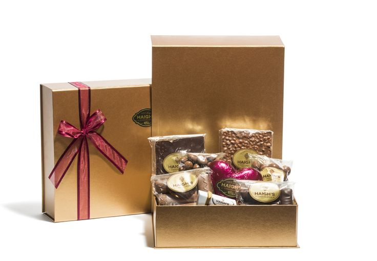 Large Gold Hamper Box ready for giving. A tempting selection of 8 delicious milk, dark and white chocoaltes in a gold box.