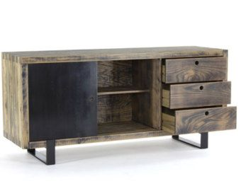 ___ // description ______________________________  low and wide, the 2 x 6 steel frame and sandblasted wood platform with built-in bedside tables makes bedtime an experience worthy of your dreams.  shown in our waxed steel finish with aged wood planks, the frame is darkened to its dark grey/blue color, then oiled and waxed to remove moisture and control patina; the platform consists of a hand-selected blend of renewable pine, douglas fir, and cedar. the wood is sandblasted to r...