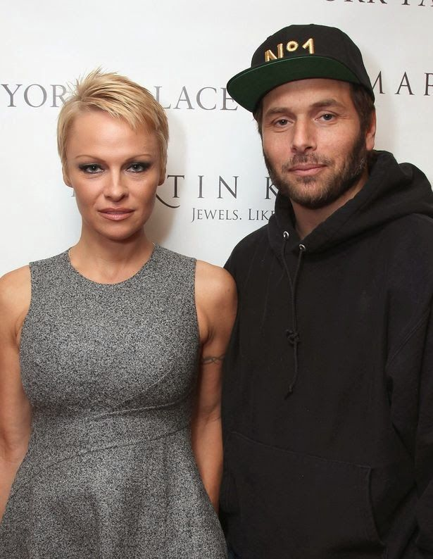 Chatter Busy: Pamela Anderson And Rick Salomon Marry Again (Wedding Ring Photos)