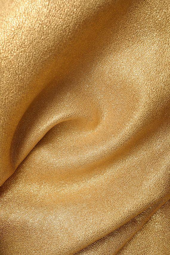 Italian leather, washed gold laminated on sand color base