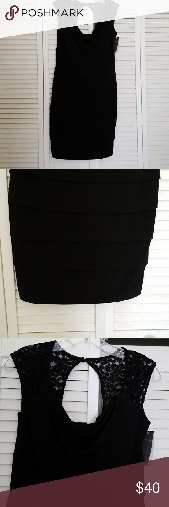 Donna Ricco bandage dress Pretty black bandage dress from Donna Ricco. It has the bandage in the front but not the back. The neckline is trimmed with lace.  The dress measures 37 inches from shoulder to hem and 14 inches from pit to pit. Donna Ricco Dresses Midi