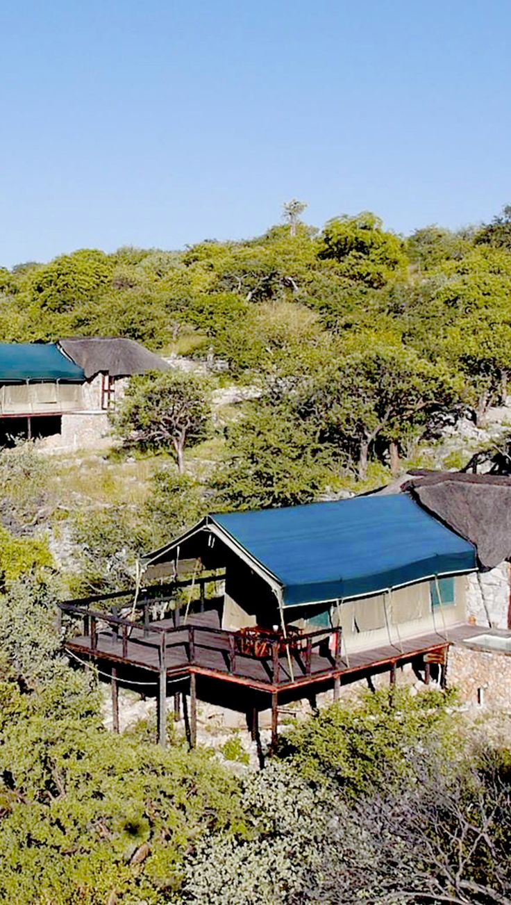 Up in the tress in Namibia are the romantic safari tents of the Eagles Tented Lodge and Spa. They are cool and chic tents and you are totally immersed in nature. Timbuktu Travel.
