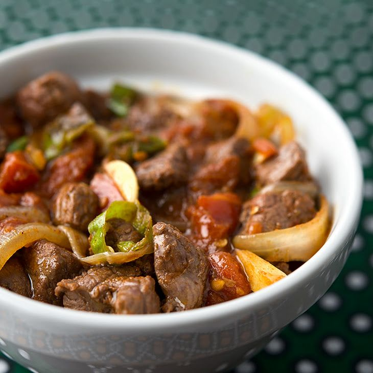 Tibs, Ethiopian Stir-Fried Beef or Venison Recipe Main Dishes with purple onion, ghee, venison, Berbere, fenugreek, cardamom, ground ginger, cumin, ground cloves, black pepper, garlic cloves, whole peeled tomatoes, green chile, red wine
