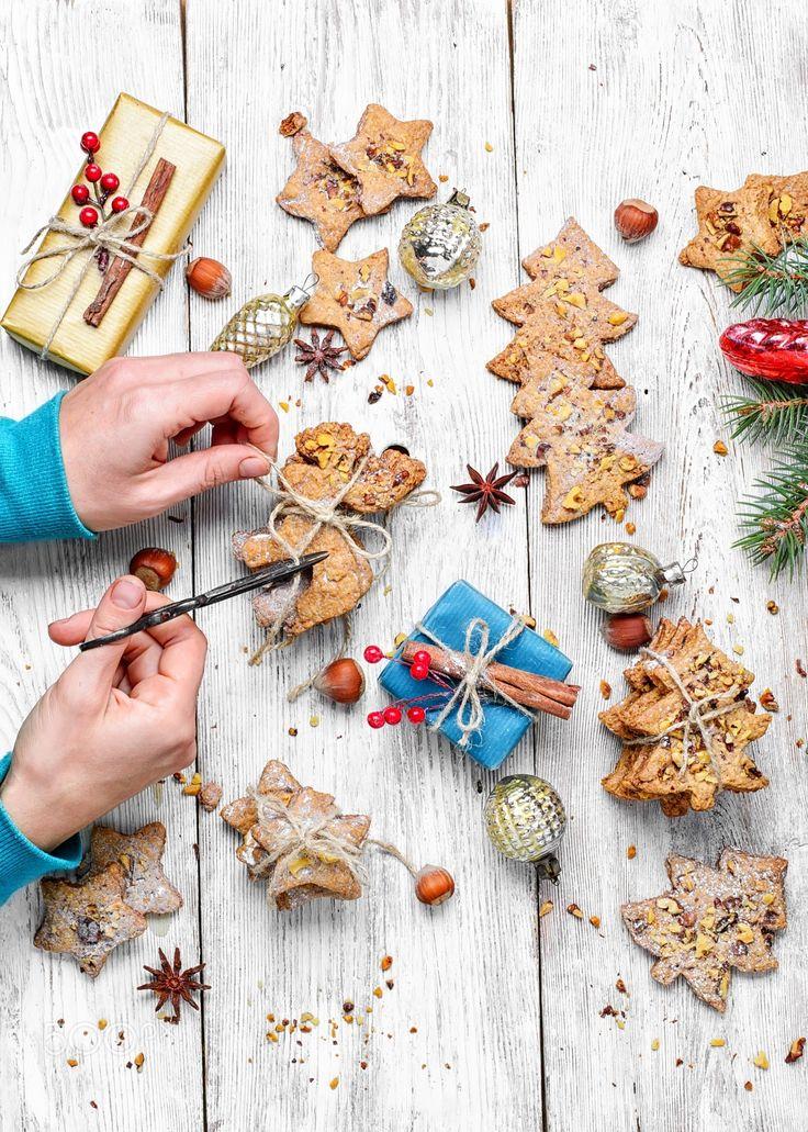 Homemade Christmas cookies - Female hands creating gifts for Christmas Christmas homemade cookies
