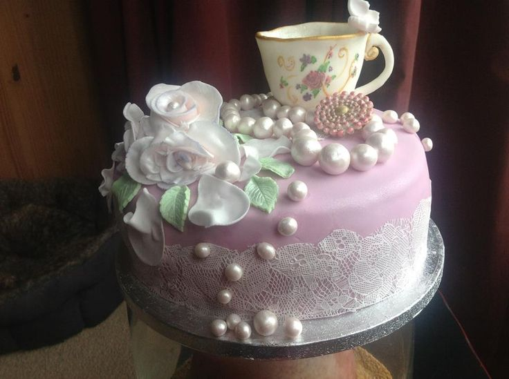 A Vintage Birthday cake...everything on the cake is edible. Even the cup..  Had this cake made for my grandmothers 80th birthday party!