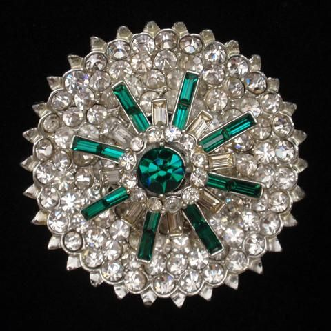 Fabulous emerald green and clear rhinestones pin in a classic design by Corocraft. Set in rhodium plated metal; the pin will keep its shine. It closes with a safety clasp. This vintage pin is hallmark