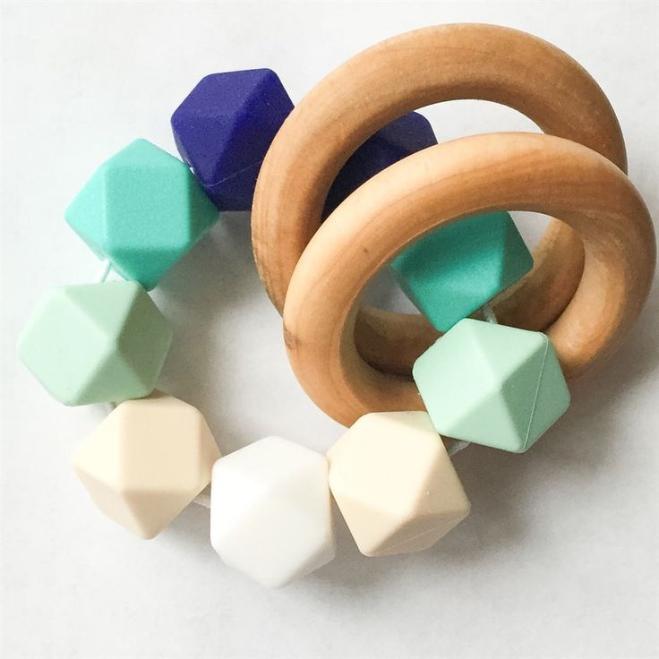 The perfect toy for your teething baby. Our teether's are handmade with care using food grade silicone beads and all natural wooden rings. The double rings make the teether easy for baby to hold. Help soothe your teething baby with a quality toy that is pleasant to you and baby's eyes. Our teether's are 100% non-toxic, BPA free, lead free, cadmium free, phthalates free, PVC free and mercury free.