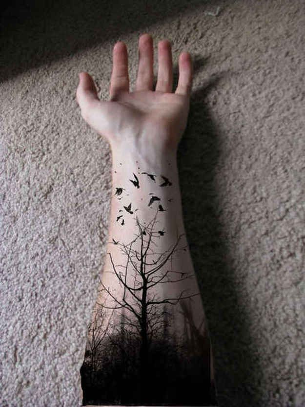 Awesome negative space nature tattoo