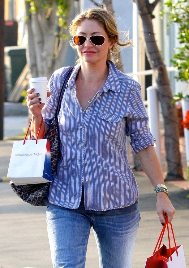 I spy Rebecca Gayheart doing some holiday shopping in West Hollywood, California wearing an Elephant Heart Charm Necklace with birthstone attachments.