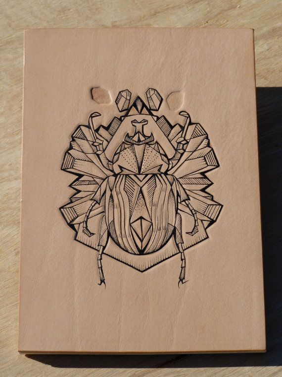 Tattooed leather art. Handmade. Inked with a tattoo machine. Original artwork. Geometric bug with crystals and gems in gift box