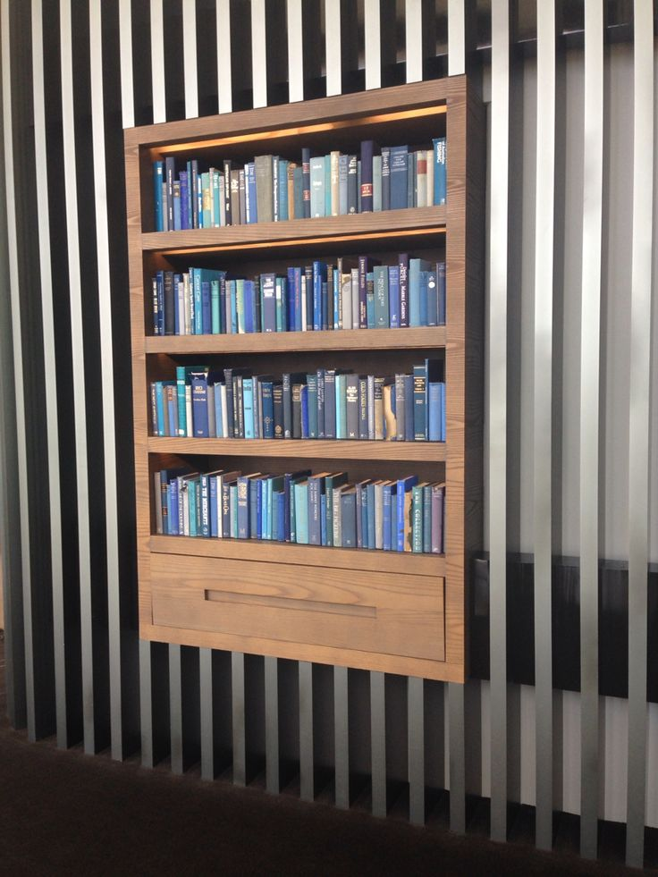 Restaurant at the crown Metropol using bookcases with fake books for both pops of colour and to break up the long rectangular separators.