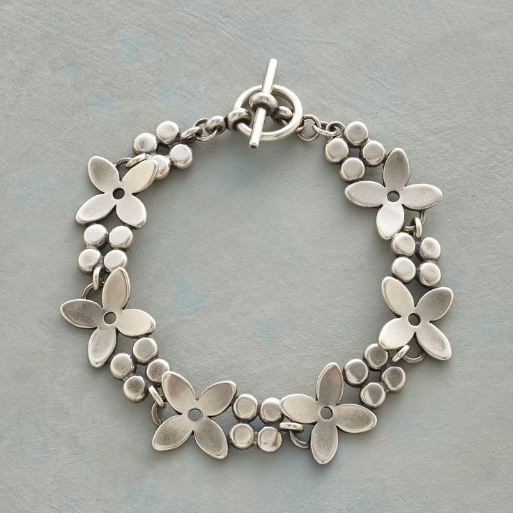 """DANICA BRACELET -- Brushed sterling silver blossoms find their influence in the uncomplicated lines of Scandinavian design. Toggle clasp. Flower bracelet handcrafted in USA. 7-1/4""""L."""