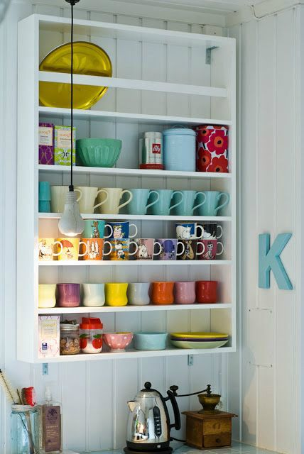 Smaller version of this shelf- I love all the mugs displayed and then some plates / jars for things.  Lights underneath.