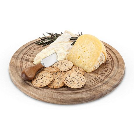 Rustic Farmhouse: Rounded Cheese Board & Knife Set - Encircling the smoothly sanded edge of this acacia wood cheese board, pretty carved letters spell out five handcrafted cheese varieties, making this the perfect way to serve all of them and more. The board is accompanied by a narrow plane knife with a matching acacia wood handle, ideal for slicing and spreading each cheese type. #LandonWinery #TXwine
