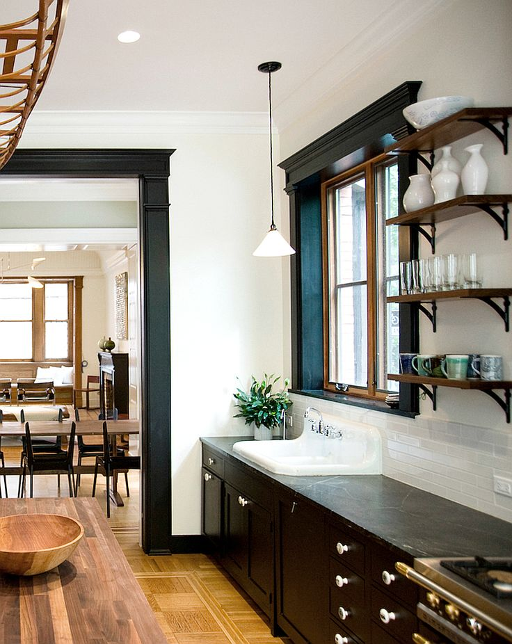 This Brooklyn brownstone townhouse has a beautiful kitchen, with an industrial twist. Featuring black cabinets and black wood trim, classic vintage sink, parquetry floor, rustic wood open shelves, plus a feature wall of exposed bricks … industrial style stools, walnut island counter & a walnut cabinet in the breakfast area. This great remodel is by Elizabeth Roberts Architect & Design, photos by …