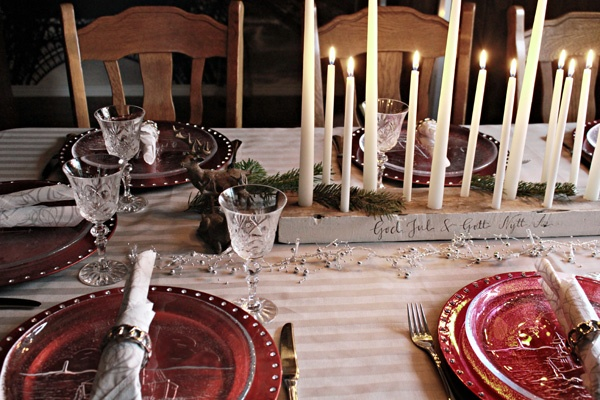 Christmas table setting in red and silver. DIY candleholder