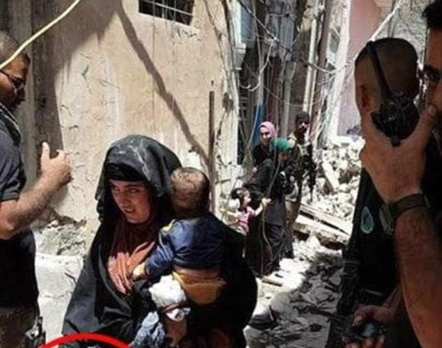 ISIS FEMALE SUICIDE BOMBER HOLDING BABY MOMENTS BEFORE BLOWING HERSELF AND THE BABY UP