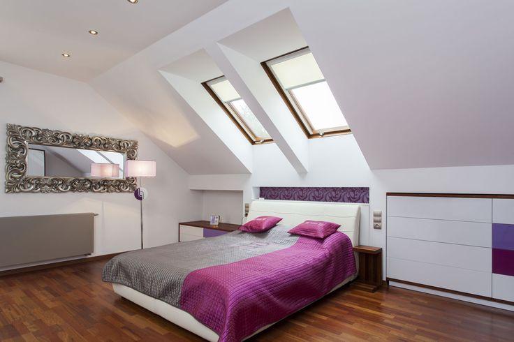 Inbouwkasten - slaapkamer op zolder - bed onder schuine kant