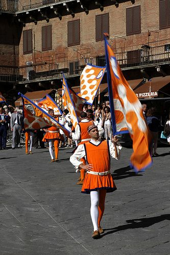 a procession by Leocorno as the contrada arrives onto the piazza