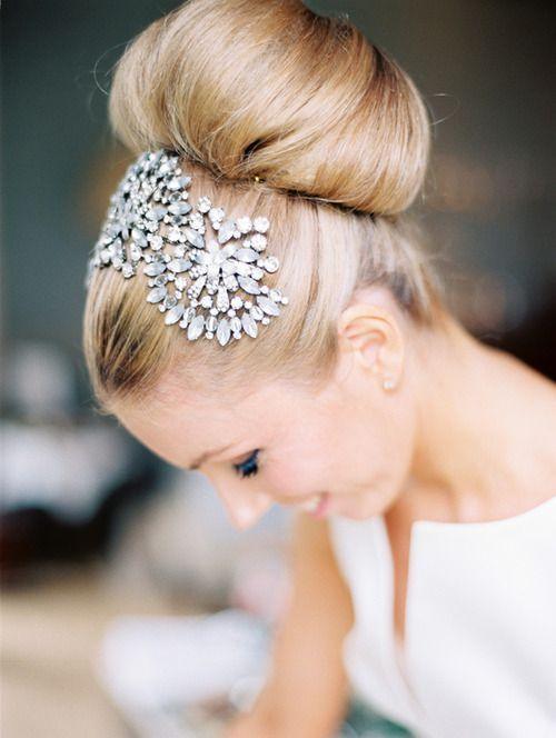 not this, but this shape. Slicked on the head like this, but with an intricate bun.  The hairpiece could go directly up the the bun and encircle it, narrowing at the bottom=where the veil can go.