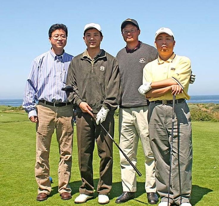 Left to right: William Ding, founder of Netease, Baidu CEO Robin Li, Jerry Yang and an unknown attendee at the 2005 Pebble Beach, Calif. summit for Chinese tech executives. Yang initially approached Baidu CEO about a partnership, but it wasn't to be. (Photo courtesy of HYSTA / Hua Yuan Science and Technology Association)