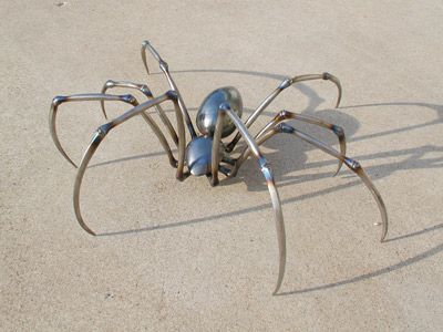 Metal Spider Sculpture by Ken Neiderer body made of spoons?