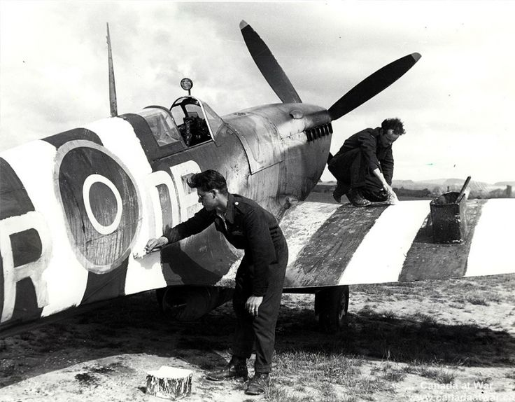 D-Day, Juno Beach - A Canadian Supermarine Spitfire recieves its D-Day markings, June 5th at Tangmere, Sussex.