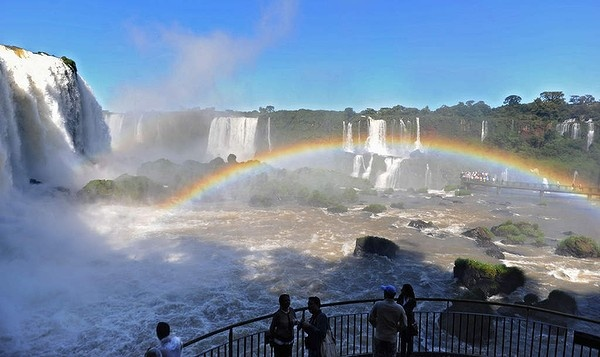 Tourists look at the Iguazu Falls (Cataratas del Iguazu in Spanish), from the Brazilian side of the Iguazu National Park which is shared with Argentina. The Falls, declared a World Heritage Site by UNESCO in 1984, is a canyon of 275 waterfalls that reach heights of 80 metres.