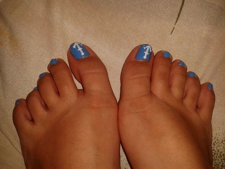 Light blue nails with white anchor