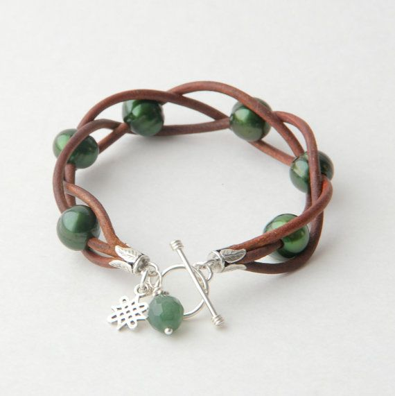 Emerald Green Pearl and Leather Bracelet. Rustic aged leather, emerald green pearls, celtic knot charm and jade.