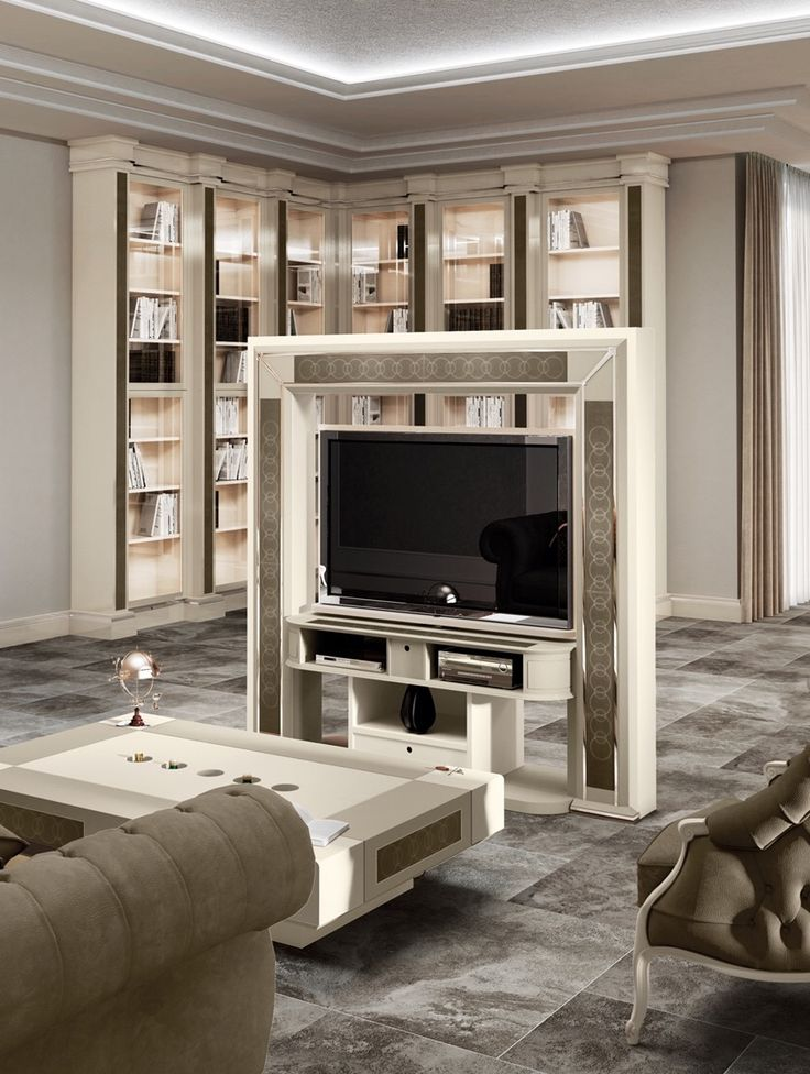 Vismara Revolving Tv Stand is an incredible piede of furniture that allows to watch tv from different sides of the room, thanks to a rotation mechanism. #vismaradesign #revolvingtvstand #luxuryfurniture #madeinitaly #italianfurniture