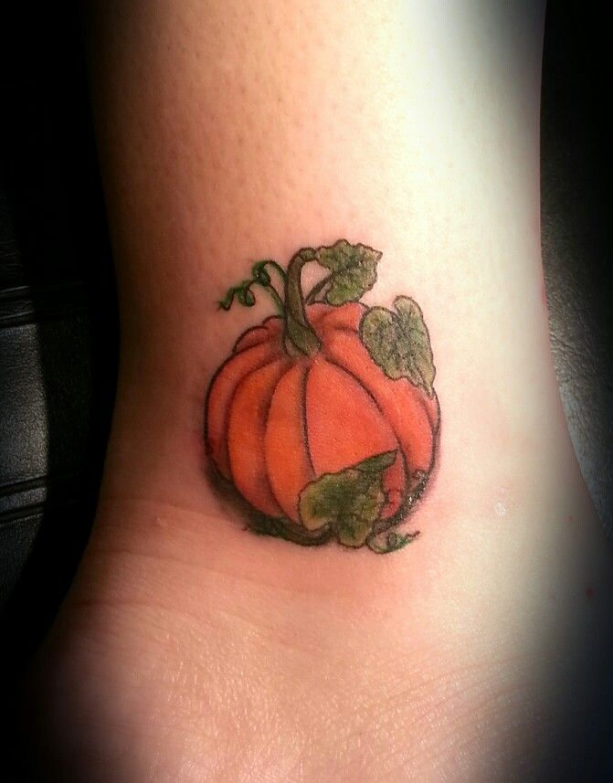 Pumpkin tattoo by Robia Fleming at Two Faced Tattoo twofacedtattoo.com