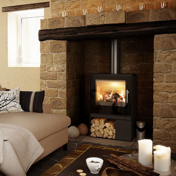 The RAIS Q-Tee 2 is a smaller stove with a very large combustion chamber, the large window offers a magnificent view of the flames and the firewood rack on the side breaks the symmetry.   #kernowfires #wadebridge #redruth #cornwall #rais #fire #stove #woo #burner #log #store #side #symmetry #fireplace #modern #contemporary #simple #design #clean #lines