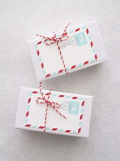 Love this red and aqua color theme for holiday gift wrapping
