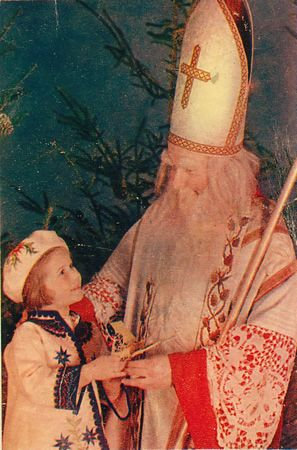 St Nicholas in white with child