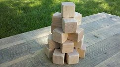 26 wood blocks measuring 1.5 x 1.5 inches. Unfinished or finished with natural child safe bees wax or coconut oil. Edges are either not sanded or sanded to round shape to make them safe for children to play with. Wood type is Oak.
