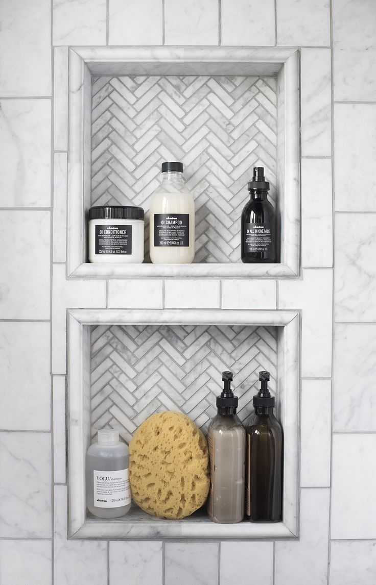 A small herringbone pattern adds nice contrast to this shower inset by roomfortuesday.com