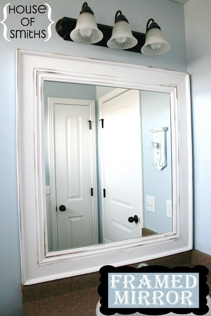 DIY Framed Mirror ...glued to mirror. ..totally doing this in both upstairs bathrooms!!
