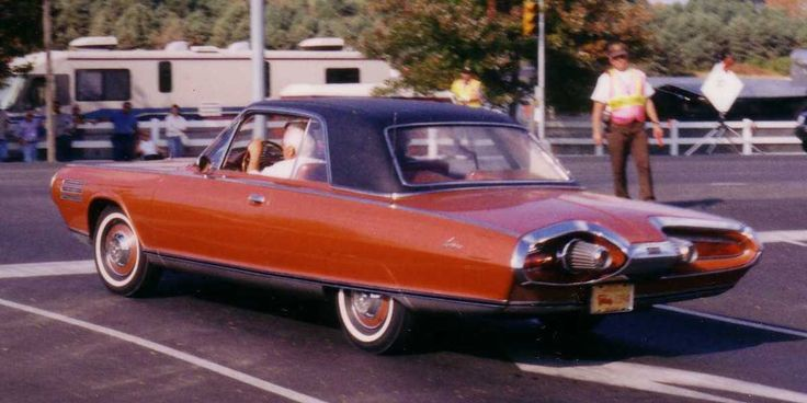 """1963 Chrysler Typhoon concept car The design was by Charles Mashigan, directed by Elwood Engel. It was """"retro futuristic"""", borrowing from ford advanced styling concepts of the 1950's. The essence of the design was used on the 4 passenger Chrysler Turbine cars https://en .wikipedia.org/wiki/Chrysler_Turbine_Car https://www.youtube.com/watch?v=5IF0VbUb_Ug"""