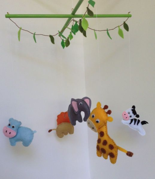 Colourful mobile featuring African animals: lion, hippo, zebra, giraffe and elephant.Other designs available on request.Please email.Keywords: Safari animal mobile, Baby mobile, nursery decor, baby gift, babyshower gift, Flights of Fancy mobile