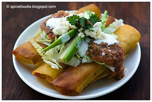 taquitos; Mexican; ingredients; fried; baked; healthy; chicken; beef; pork; low fat; tomato; onion; chili pepper; green; garlic; tortillas; corn; spices; recipes; easy; cuisine; how to; feta cheese; crumbled cheese; sour cream; avocado; cilantro; plate
