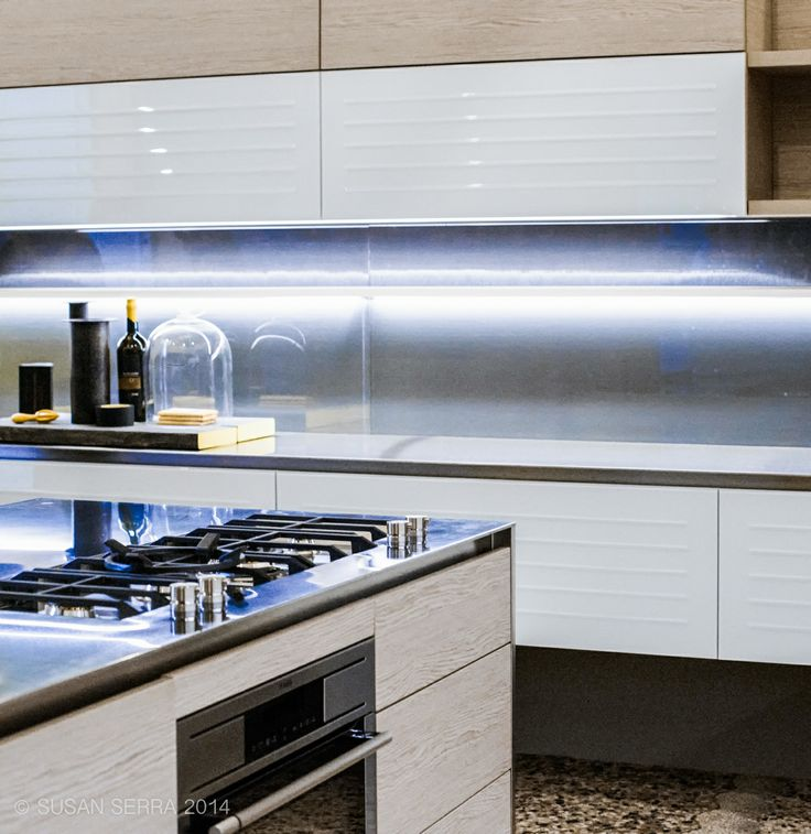 Kitchen Design Trends at Eurocucina, Milan 2014 - large kitchen cabinet sections, molded stainless steel countertops and backsplash, light woods, texture