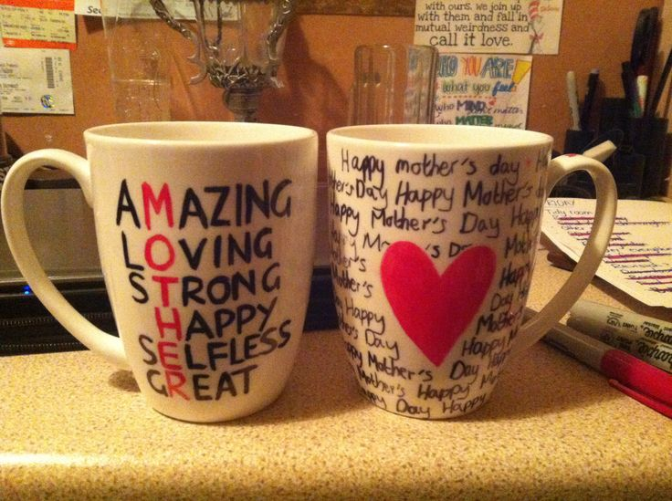Homemade Mother's Day mugs - drawn on plain mugs with sharpies and then heated in the oven at 180 degrees for 30 mins!