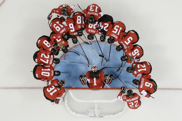 Team Canada huddles before their game against Finland during the 2014 Sochi Winter Olympics