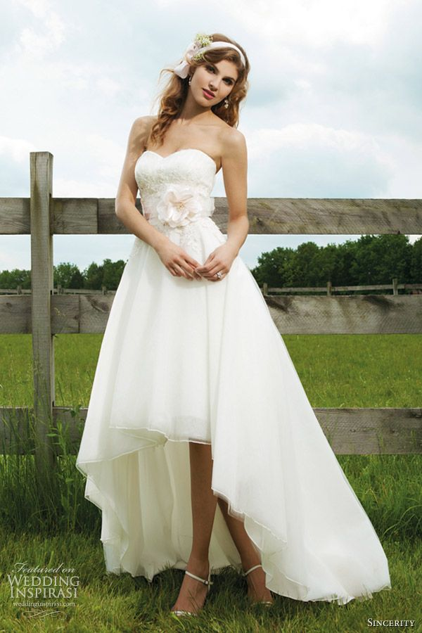 Sincerity Bridal Wedding Dresses 2012  Strapless soft sweetheart of vertical pleated tulle, beaded lace accents this midriff, with tulle high low hem line, sweep train, detachable satin bias band belt with flowers.