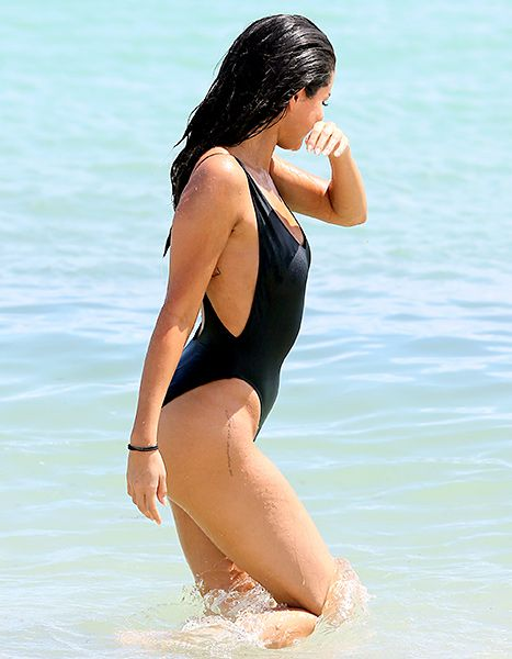 Selena Gomez looks sexy yet classy in a black one-piece swimsuit on the beach in Miami on September 19, 2015.